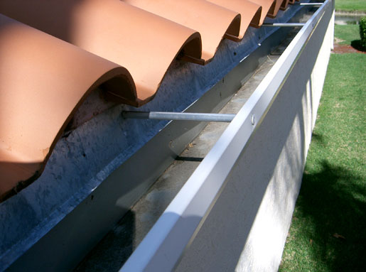 Gutters screen enclosures pressure cleaning and roofing any this photo depicts the right way to install seamless gutters the gutter is behind the metal flashing and right below the roof tile solutioingenieria Images